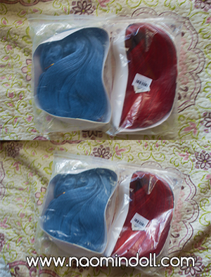 two rosewholesale wigs in packaging, red wig, sky blue wig